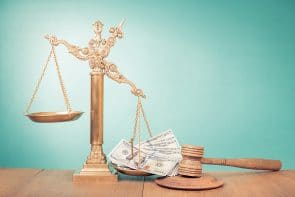 Legal scale with gavel and money