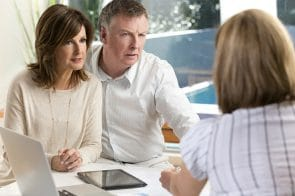 Worried mature Couple in Meeting With Mediator