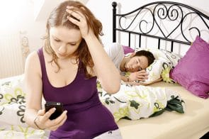 Wife checking her husband's mobile