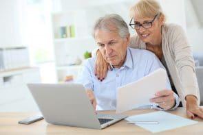Elderly couple filling an online form