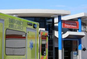 Ambulance vehicle parked outside of hospital emergency department