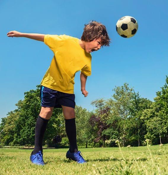 A boy heading a ball
